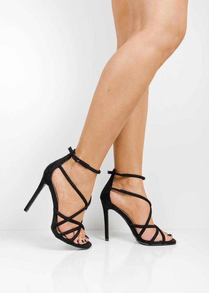 20eefdf977a ... strappy high heel sandals. 🔍. Previous  Next