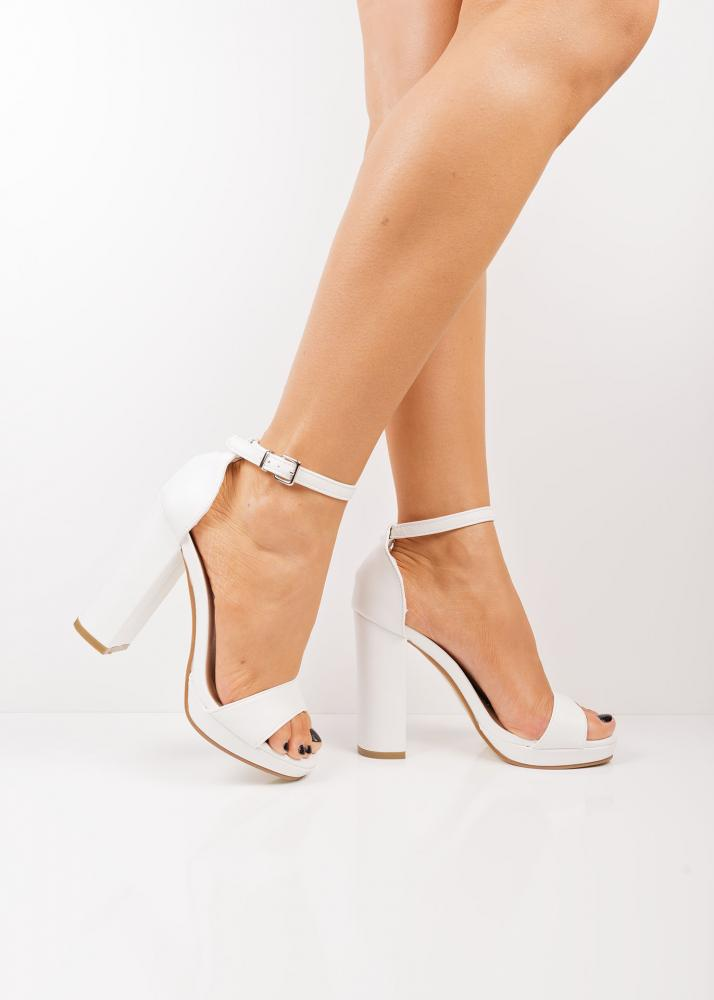 48c119ec22c ... White platform block heel sandals. 🔍. Previous  Next